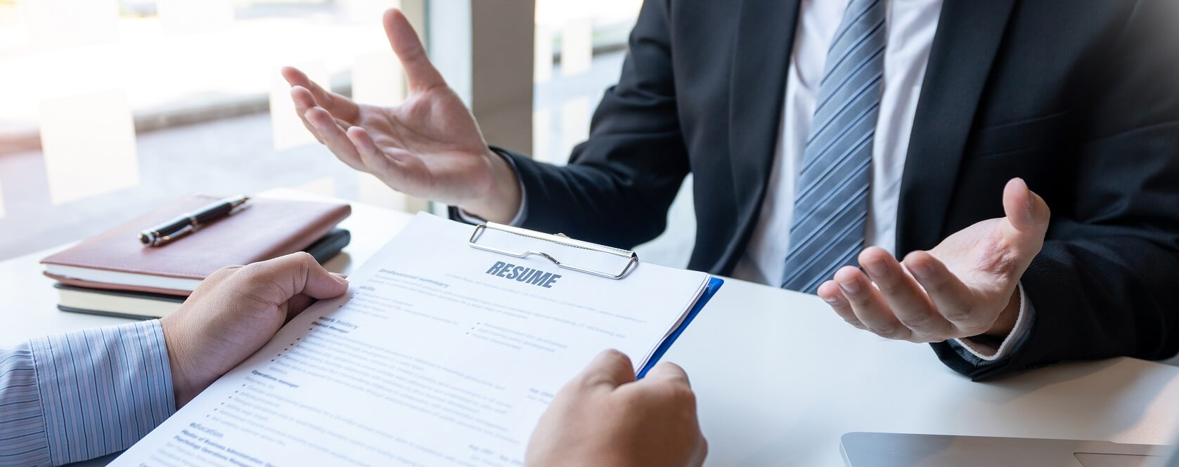 Interview the job and hiring, men candidate at job interview explaining about his profile to business manager in modern office space. Business consulting or employment concept